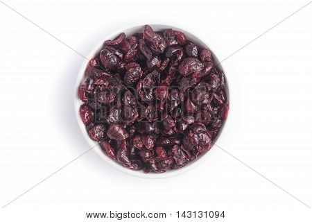 Dried Cranberries into a bowl over a white background