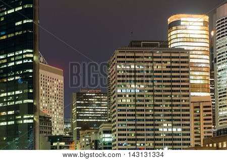 Modern cityscape at night background. Skyscrapers of Sydney downtown at dusk. Copy space long exposure