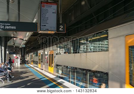 Sydney Australia - Jul 10 2016: Platform on Circular Quay train station with Sydney Trains service route for T3 line display and carriage in motion