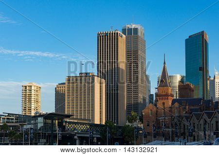 Sydney Australia - Jul 10 2016: Modern skyscrapers of Sydney Central Business District with Overseas Passenger Terminal and historic Australasian Steam Navigation Co building in Anglo-Dutch style