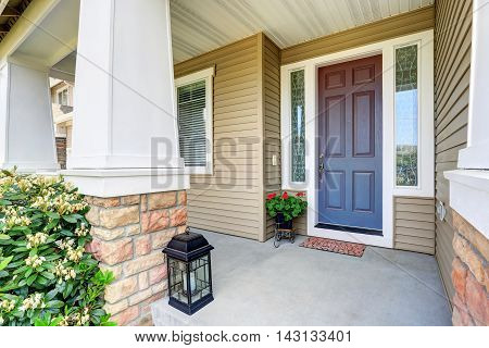 Front Entry Door With Concrete Floor Porch And Flowers Pot