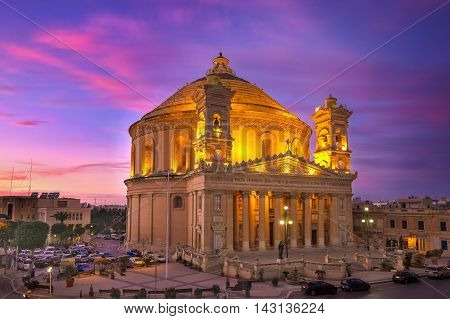 Malta - The Famous Mosta Dome after sunset with beautiful colorful sky