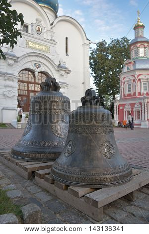Sergiev Posad Russia - August 29 2015: Two bells on the Cathedral square in Holy Trinity St. Sergius Lavra. Sergiyev Posad is included into the Golden ring of Russia and is a pilgrimage center of the Christian world.