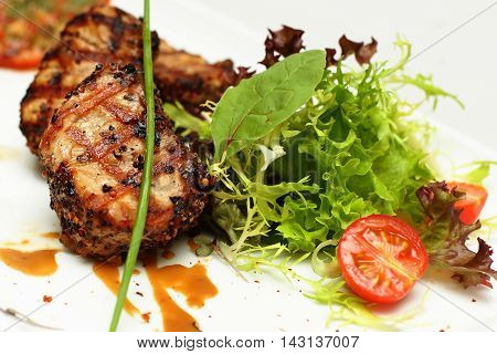 Gourmet food restaurant meat on white plate