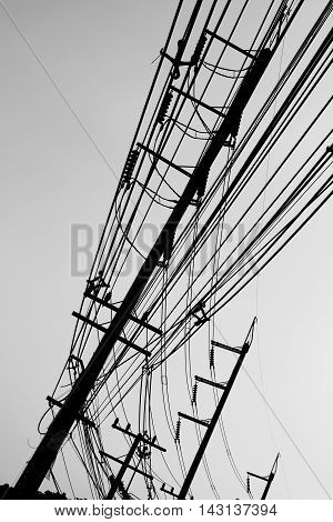 Electric pole and wire in white background. Shoot in black and white shot.