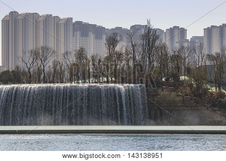 Kunming, China - March 4, 2016: Kunming Waterfall Park Featuring A 400 Meter Wide Manmade Waterfall.