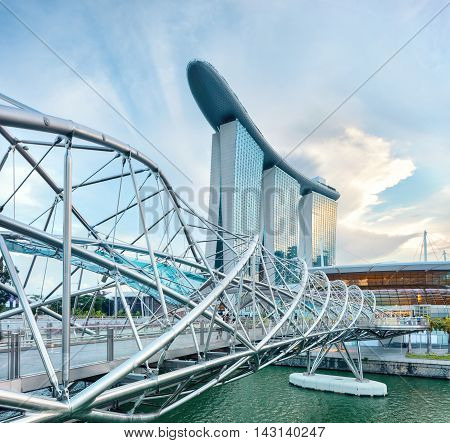 Singapore, Republic of Singapore - May 3, 2016: Helix spiral double bridge leading to Marina Bay Sands hotel
