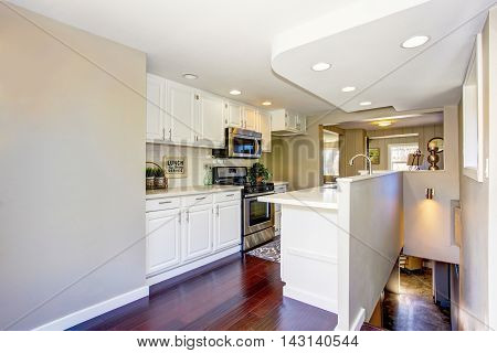 Classic American Kitchen Room With White Cabinets And Hardwood Floor