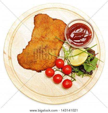 Schnitzel or escalope top view on white