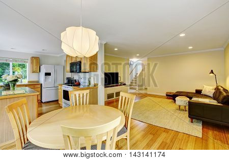 Open Floor Plan Kitchen And Living Room. Also Dining Area At The Foreground