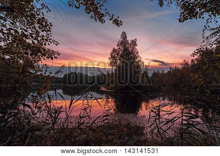 Beautiful sunset over the lake with reflection