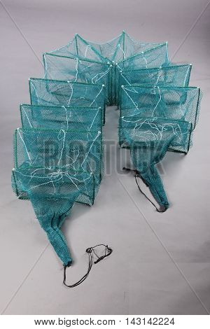 Harvest gear of rectangular fish cage for fishing tackle on grey background