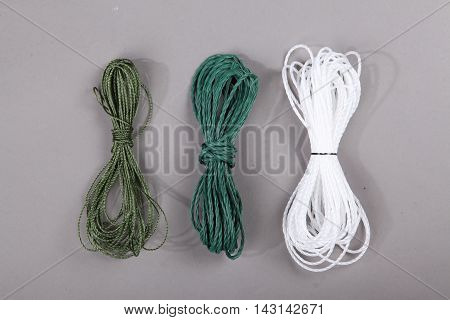 Harvest fishing tackle of plastic waterline on grey background