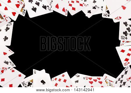Frame of playing cards on a black background
