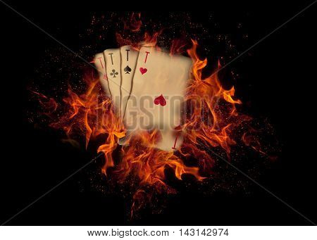 vintage playing cards on fire. casino concept.