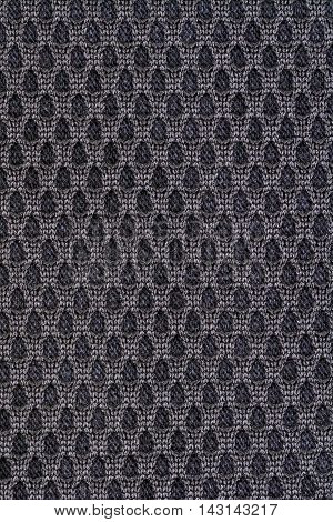 Black decorative polyester fabric texture background, close up