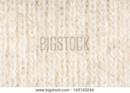 Beige and white woolen fabric texture background, close up
