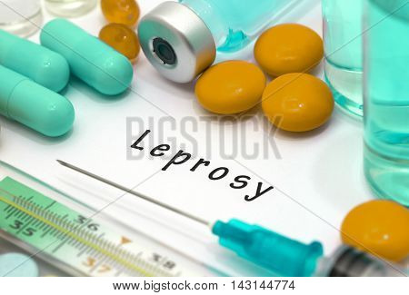 Leprosy - diagnosis written on a white piece of paper. Syringe and vaccine with drugs.