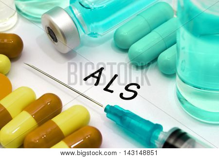 ALS (amyotrophic lateral sclerosis) - diagnosis written on a white piece of paper. Syringe and vaccine with drugs.