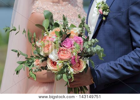 Bride Holding A Beautiful Bridal Bouquet. Wedding Bouquet Of Peach Roses By David Austin,  Single-he