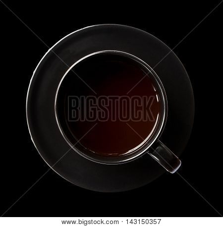 Black cup of coffee with black background.