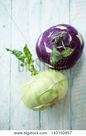 Fresh kohlrabi on the wooden table, closeup