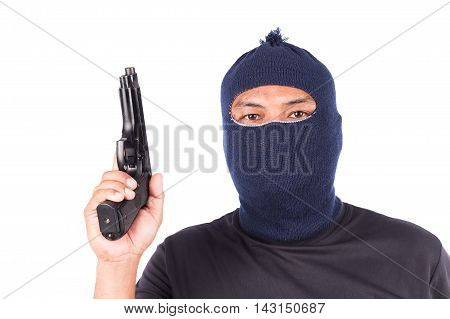 Young man holding gun on white background