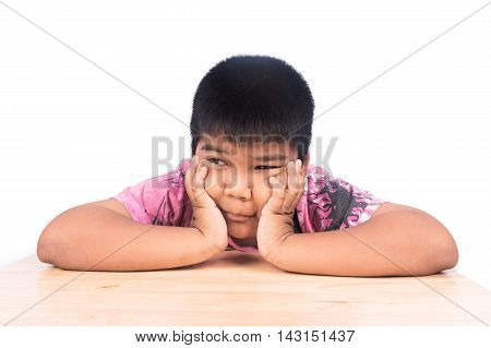 Boy sad siting alone at wooden tableblack and white