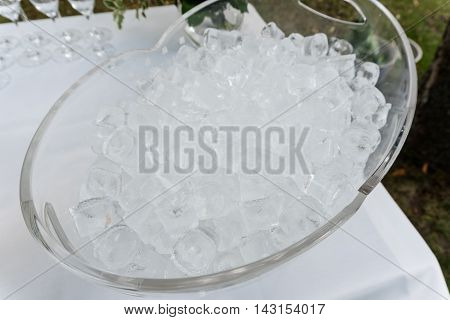 The texture of the ice cubes, frozen cubes of ice. Cocktail ice