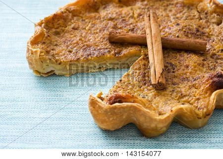 Delicious homemade pumpkin pie on blue background