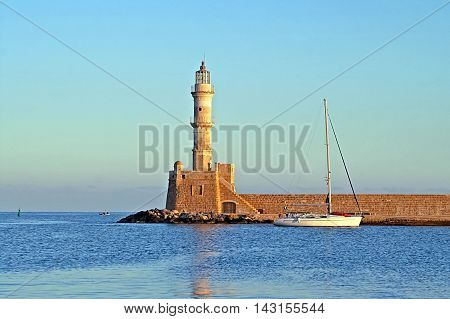 Old venetian lighthouse of Chania in Crete, Greece on the sunrise