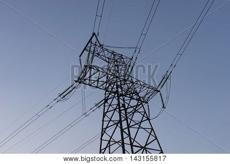 Electricity pylons against the blue sky background