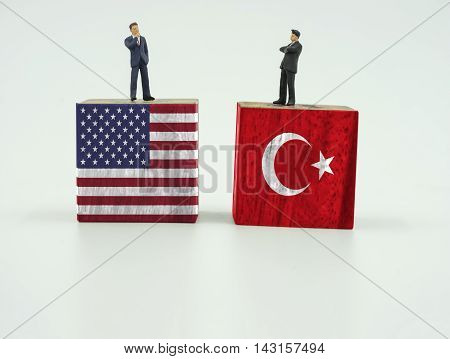 double mini leader of two country on wood block of usa and turkey flag on isolate on white background - can use to display or montage on products