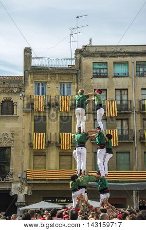 Reus, Spain. October 25, 2014: Castells Performance, a castell is a human tower built traditionally in festivals within Catalonia.