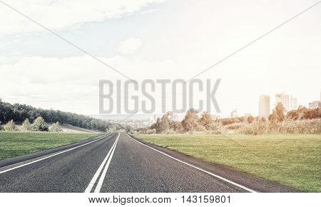 Natural summer landscape with asphalt road to horizon