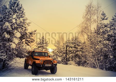 Leningrad oblast , the Karelian isthmus, Russia , February 22, 2016 , Jeep Wrangler for forest snow-covered road, the Jeep Wrangler is a compact four wheel drive off road and sport utility vehicle