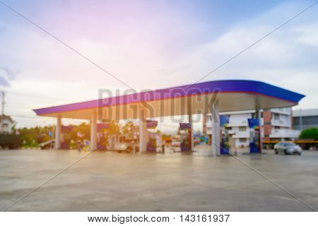 Blurred background of gas station with sunlight.