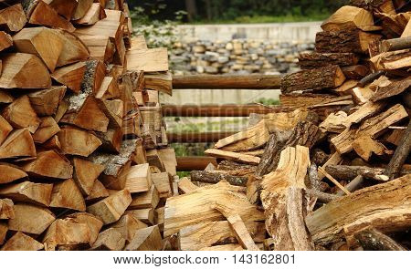 Wood stacking method. Firewood piles at countryside stock photo