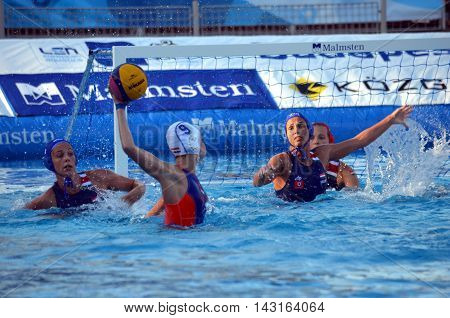 Budapest, Hungary - Jul 16, 2014. Hungary's Rita Keszthelyi (HUN, 8) defending against MEGENS Maud (NED, 9). The Waterpolo European Championship was held in Alfred Hajos Swimming Centre in 2014.
