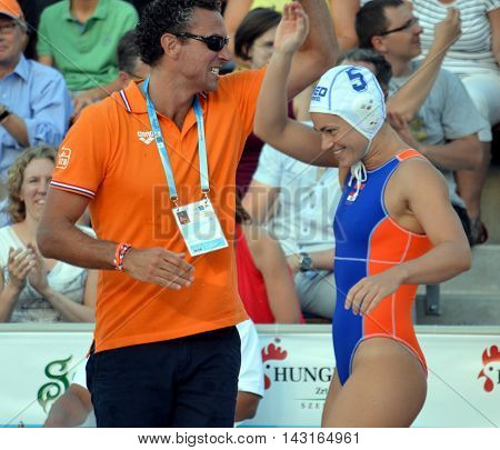 Budapest, Hungary - Jul 16, 2014. Netherland's HAVENGA Arno head coach and GENEE Amarens Dousten (NED, 5) are very happy after winning. The Waterpolo European Championship was held in Alfred Hajos Swimming Centre in 2014.