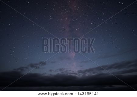 The milky way galaxy with clouds streaking