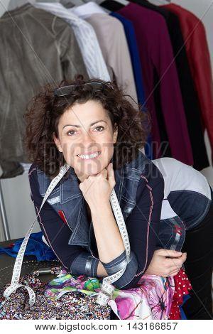 A Portrait of smiling fashion designer woman