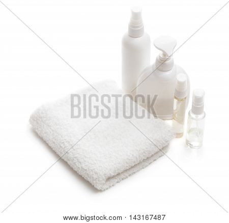 White Towel And Bottles With Cosmetics