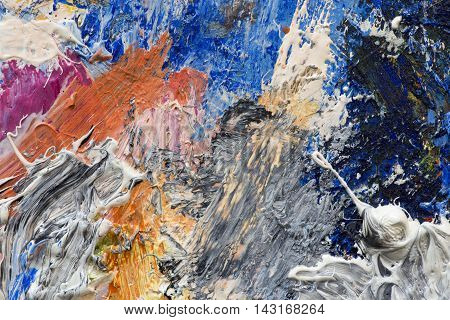 Abstract background of oil paints on an artist's palette