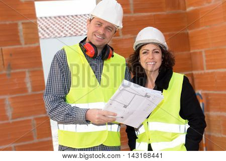 Staff On A Site Under Construction , Man And Woman