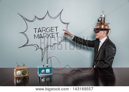 Target Market concept with vintage businessman pointing hand
