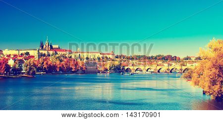 Prague Castle and Old City day view with blue sky, travel vivid autumn european background in hipster vintage style