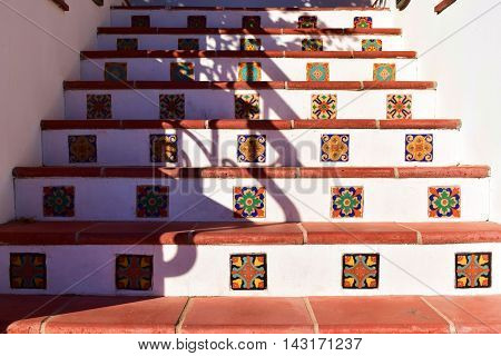 Historical stairs with Spanish tiles taken at a courtyard in a residential hacienda villa