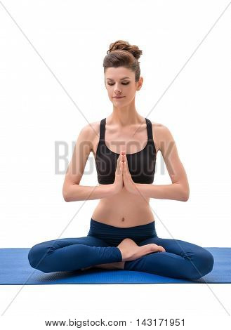 Yoga instructor sitting in lotus position. Isolated on white background