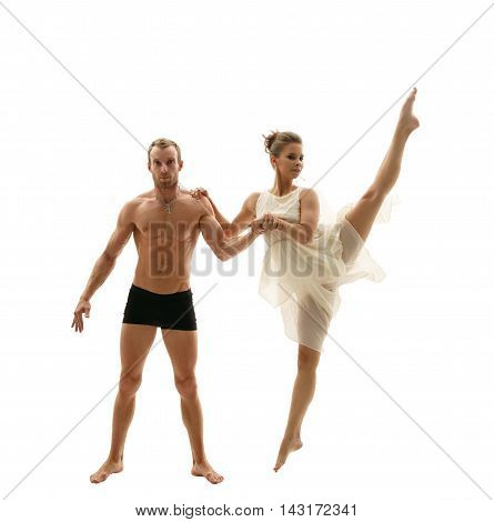 Image of focused gymnast and his pretty flexible partner
